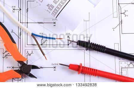 Cables Of Multimeter, Pliers, Electric Wire And Construction Drawing