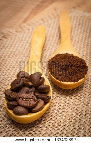 Grains And Ground Coffee With Wooden Spoon On Jute Canvas