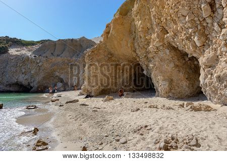 MELOS GREECE - SEPTEMBER 5 2012: Tsigrado beach on the south coast of Melos island with few people.