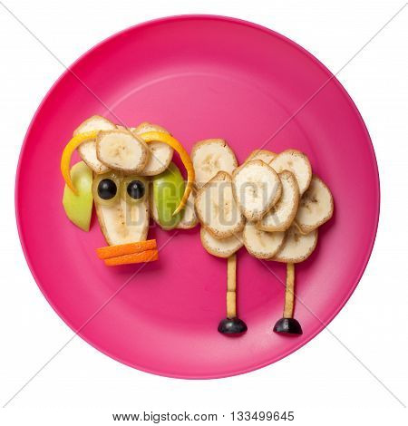 Ram made of fruits on pink plate