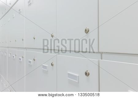 group of unused lockers cabinet room .