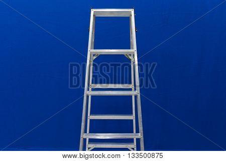 Ladder on blue background ,Furniture concept .