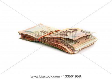 Stacks of  Thai money banknotes on white background.