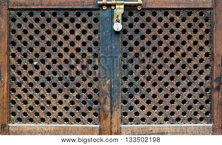 Locked wooden Nepalese door and window called Ankhi jhyal
