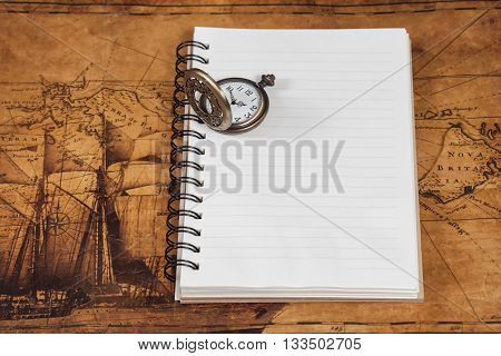 Antique watch on book wooden background.Vintage style.