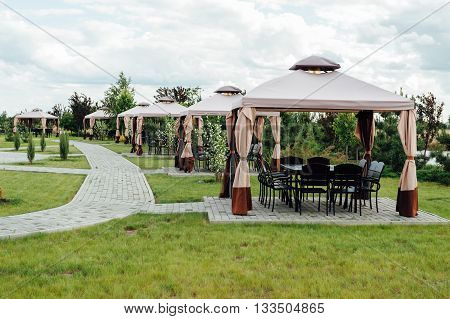 Picture of beauty garden with modern gazebo.