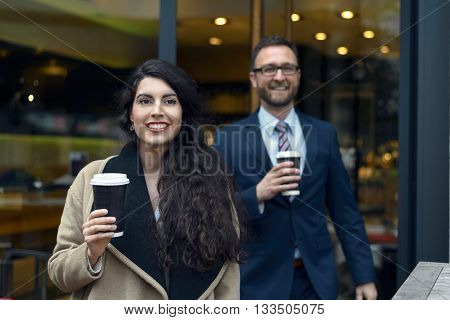 Two Business Colleagues Purchasing Takeaway Coffee