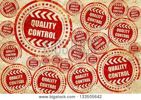 Quality control background, red stamp on a grunge paper texture