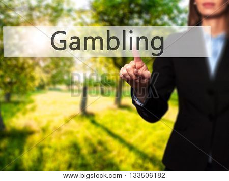 Gambling - Businesswoman Hand Pressing Button On Touch Screen Interface.