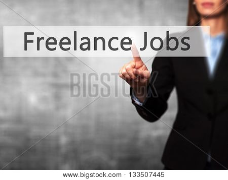 Freelance Jobs - Businesswoman Hand Pressing Button On Touch Screen Interface.