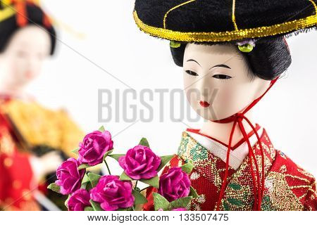 Japanese geisha dolls on the white background.
