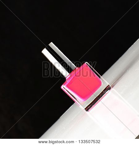 Bottle Pink Nail Stands On The Inclined Surface