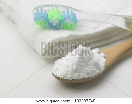 Toothbrush and baking soda to clean