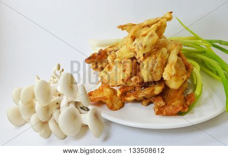 batter-fried oyster mushroom on the white dish