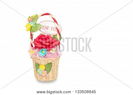 artificial roses in rattan basket on white background