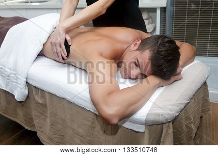 Handsome Man Getting Massage With Hot Stones