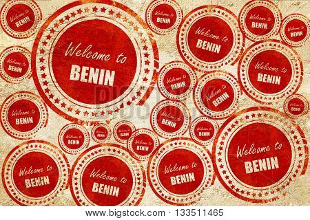 Welcome to benin, red stamp on a grunge paper texture
