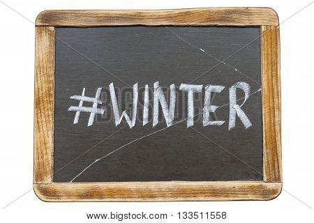 winter hashtag handwritten on vintage school slate board isolated on white