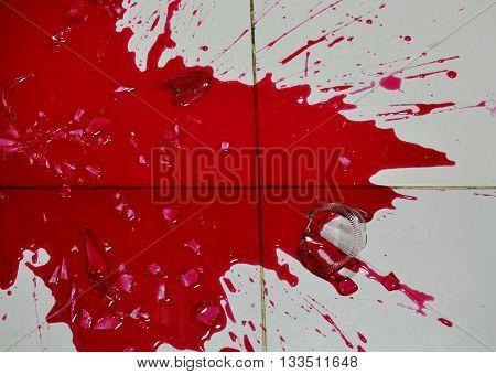 red nectar concentration splash on floor after bottle broken