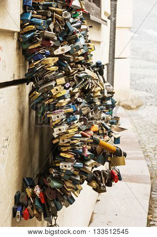 Many locks of love in wave shape. Symbol of lovers. Vertical composition. Valentine's Day. Symbolic locks.