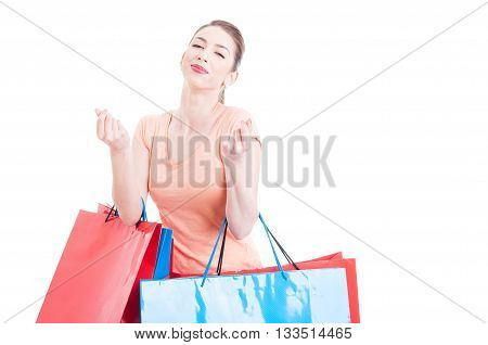 Woman With Shopping Bags Making Spending Money Gesture