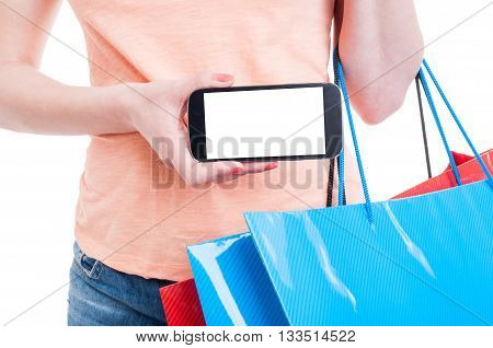 Female Shopper Holding Mobile Phone With Blank Display