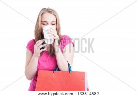 Beautiful Young Woman Drinking Hot Coffee And Relaxing On Shopping