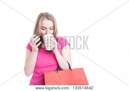 Beautiful Young Woman Holding Coffee Cup And Shopping Bags
