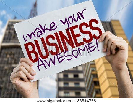 Make Your Business Awesome placard with cityscape background