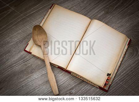chef recipe recipe book with wooden ladle