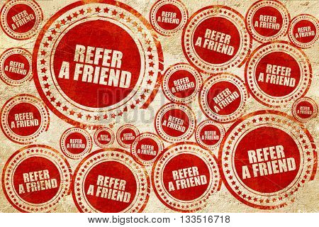 refer a friend, red stamp on a grunge paper texture