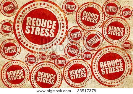 reduce stress, red stamp on a grunge paper texture