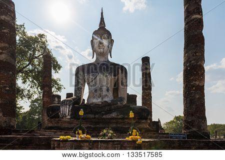 Wat mahatat Sukhothai Historical park Thailand. Beautiful statue of Buddha smiling