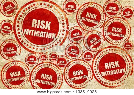 Risk mitigation sign, red stamp on a grunge paper texture