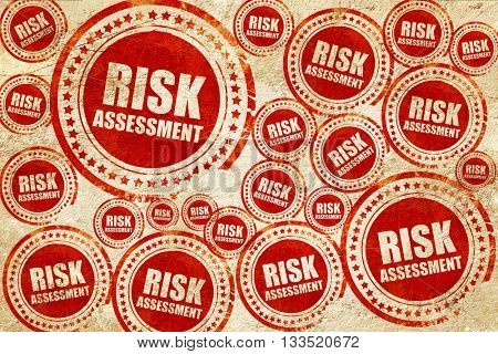 risk assessment, red stamp on a grunge paper texture