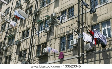 Shanghai, China - Apr 22, 2013: Clothes being hanged outside Chinese flat of an old residential building in the Pudong New District (Lujiazui) of Shanghai city.