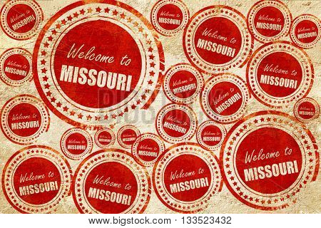 Welcome to missouri, red stamp on a grunge paper texture
