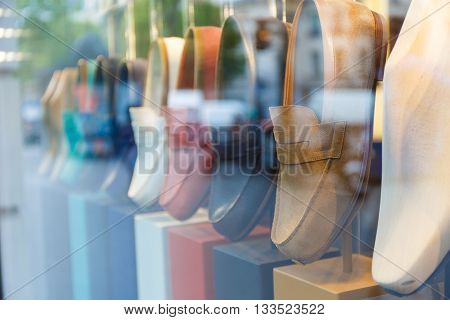 Showcase with shoes of different colors in the street