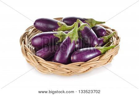 purple eggplant with stem in rattan basket on white background