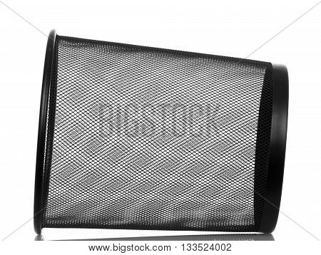 An empty metal dustbin is isolated on white background.