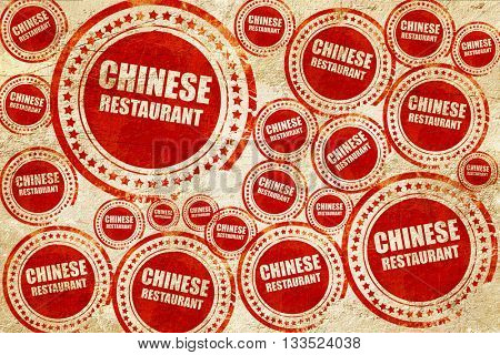 Delicious chinese restaurant, red stamp on a grunge paper textur