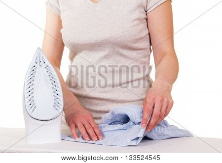 Steam iron, women's hands and shirt for ironing isolated on white background.