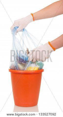 Women's hands are removed from the plastic bucket bag with household waste isolated on white background.