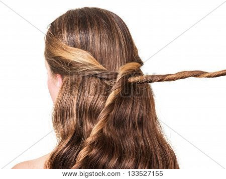 Girl with long brown hair intertwined isolated on white background.