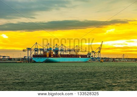 Container ship at sunset in Port of Gdansk Poland.