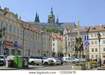 Prague Czech - 03 July 2015: Lesser Town Square with the Trinity column and Prague Castle on the background