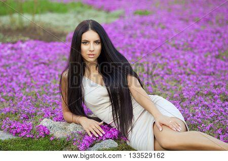 Sexy brunette woman on purple flower field