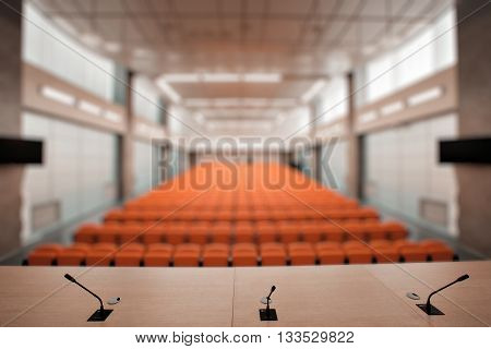 Rostrum with microphone and computer in conference hall