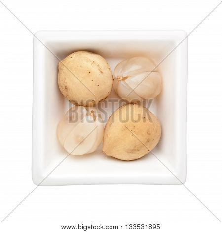 Langsat fruits in a square bowl isolated on white background