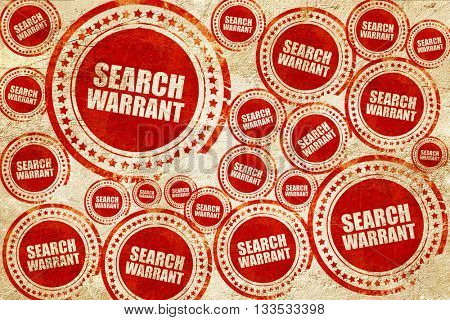search warrant, red stamp on a grunge paper texture